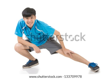 Asian sport young man stretch and warm, full length portrait isolated on white background.