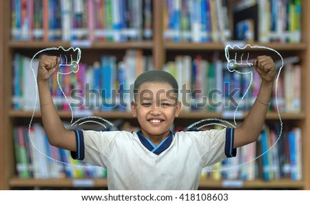 Asian strong children on Abstract blurred photo of library background, education concept