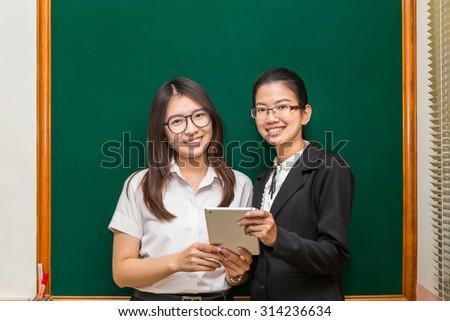 Asian student and teacher in classroom,Bangkok Thailand - stock photo