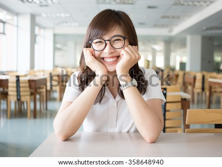 Asian student in library of university - stock photo