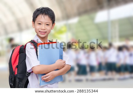 Asian student in uniform at school - stock photo