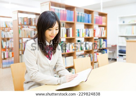 asian student studying in the library