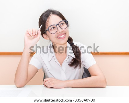Asian student  think about something in classroom - stock photo