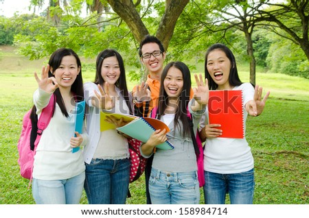 Asian students making ok sign - stock photo