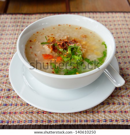 Asian style breakfast soft boiled rice, rice soup - stock photo