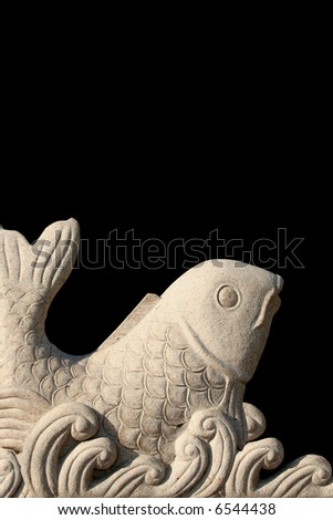 Asian style carved stone koi fish