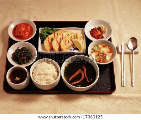 Asian Style Cooking isolated - for celebration party with healthy and tasty cuisine / fry filleted fish, watery plain kimchi, persimmon punch and others delicious Korean traditional food - stock photo