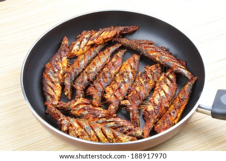 Asian style fish fry in the frying pan. - stock photo