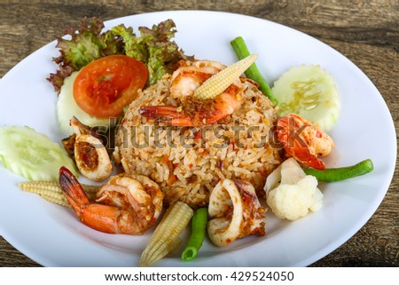 Asian style Fried rice with seafood, herbs and spices - stock photo