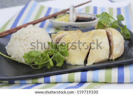 Asian style: Hainan boiled chicken with steamed rice - stock photo