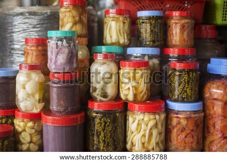 asian style mixed vegetable and seafood pickles in kep market cambodia