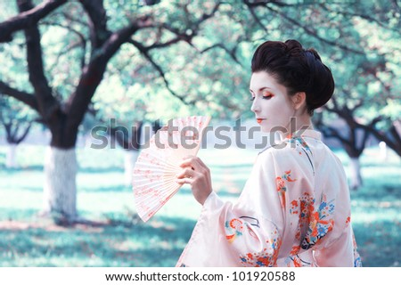 Asian style portrait of young woman in the garden - stock photo