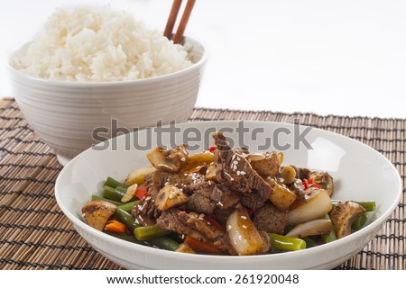 Asian style stir Fried meat and vegetables on white rice  - stock photo