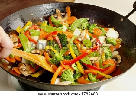 Asian-style stir-fry cooking in a well-used wok