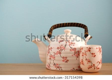 Asian style tea pot background - stock photo