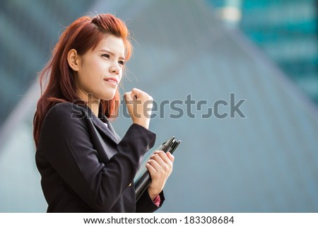 asian success Businesswoman holding document file at outdoor office.