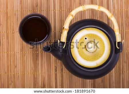 Asian tea set on bamboo mat - stock photo