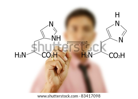 Asian teacher writing scientific formula on the whiteboard. - stock photo