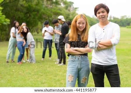 Asian teenager couple smiling outdoors