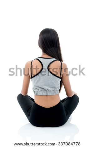 Asian teenager doing stretching exercise on white. - stock photo