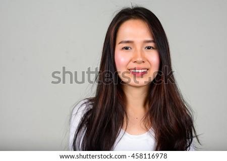 Asian teenager girl smiling - stock photo