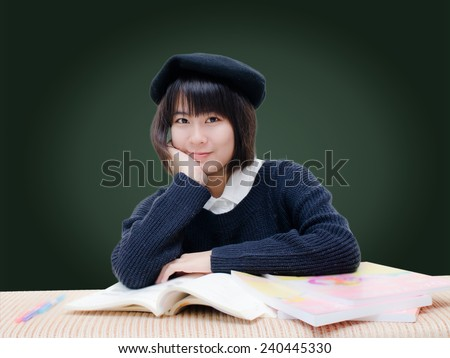 Asian teenager reading books. - stock photo