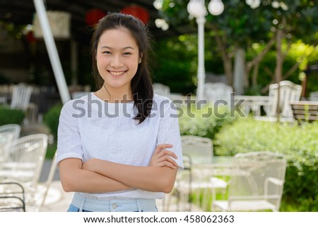 Asian teenager woman smiling outdoors