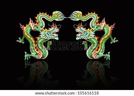 Asian temple twin green dragon on black background with reflection