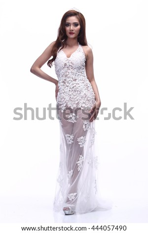 Asian Thai Female Woman Model Tan Skin in Lace See Through White Wedding dress with Tiara and High Heel, Fashion Make Up, Studio Lighting on White Background