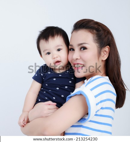 Asian Thai mom and pretty son smiling isolated