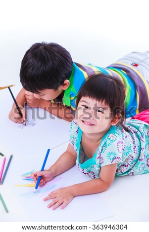 Asian (thai) sibling happily, sister looking at the camera and smiling, on white background. Concepts of creativity and education, strengthen the imagination of child. Studio shot. - stock photo