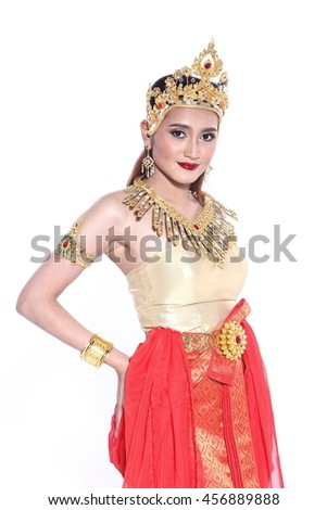 Asian Thai Woman In Traditional Costume Of Thailand in ancient house at Siam and Southeast Asia, Studio lighting, local fabric style