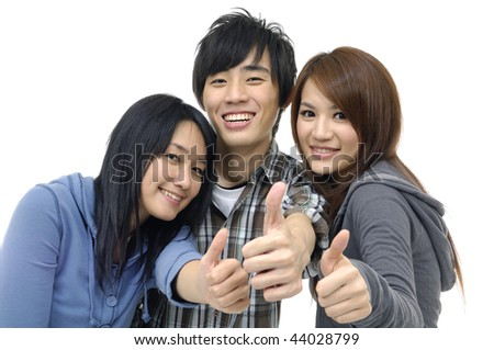 Asian three young teenagers laughing and giving the thumbs-up sign. - stock photo