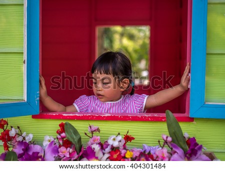 Asian toddler girl in happy time in summer