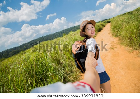 Asian tourists hiking trip with her lover her boyfriend holding hands - stock photo