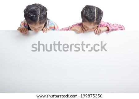 Asian twin sisters  behind empty billboard look at the billboard  isolated on white background