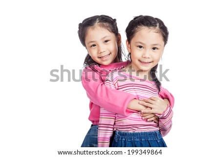 Asian twin sisters very happy look at camera