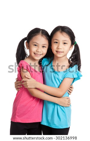 Harness female asian twins
