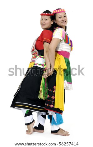 Asian two woman in traditional dress back to back