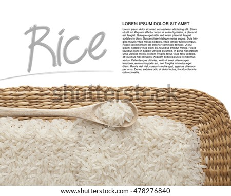 Asian uncooked white rice in a wooden spoon on a background of straw.