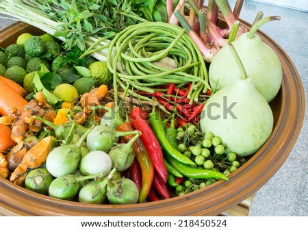 asian vegetables on wooden plate in local market - stock photo