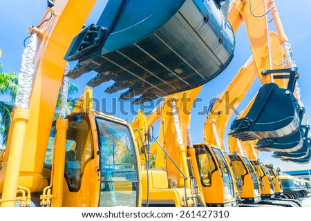 Asian Vehicle fleet with construction machinery of building or mining company - stock photo