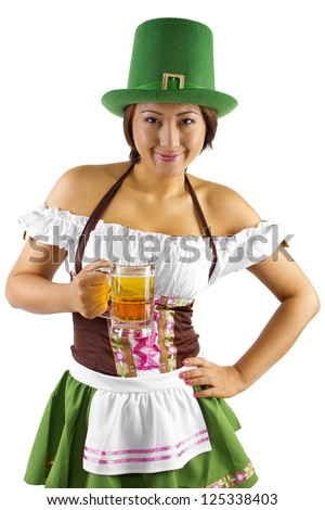 Asian waitress in a St Patricks Day costume holding a mug of beer.