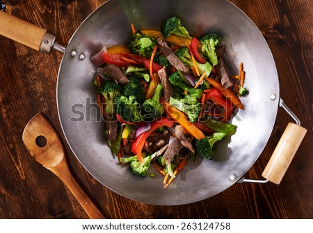 asian wok stir fry shot from over head - stock photo