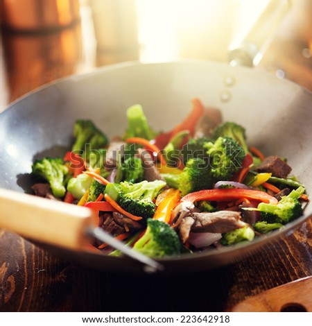 asian wok with beef and vegetable stir fry - stock photo