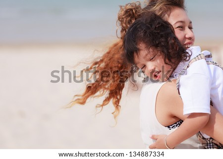 Asian woman and young boy - stock photo