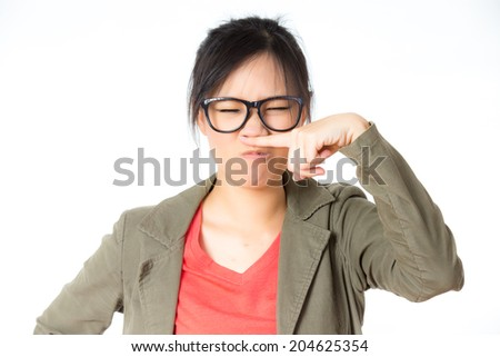 asian woman annoyed by bad smell - stock photo