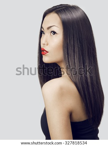 Asian woman beauty face closeup portrait. Beautiful attractive girl with long shiny dark  hairs.