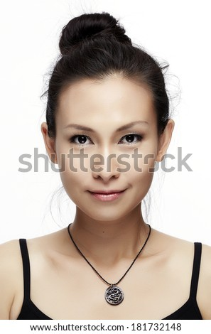 Asian woman beauty face closeup portrait. Beautiful attractive mixed race Chinese Asian / Caucasian female model with perfect skin isolated on white background - stock photo