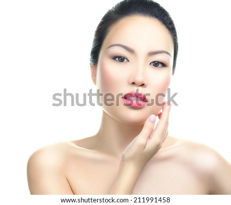 Asian woman beauty face closeup portrait. Beautiful attractive mixed race Chinese Asian / Caucasian female model with perfect skin, manicure and day make up, isolated on white background - stock photo